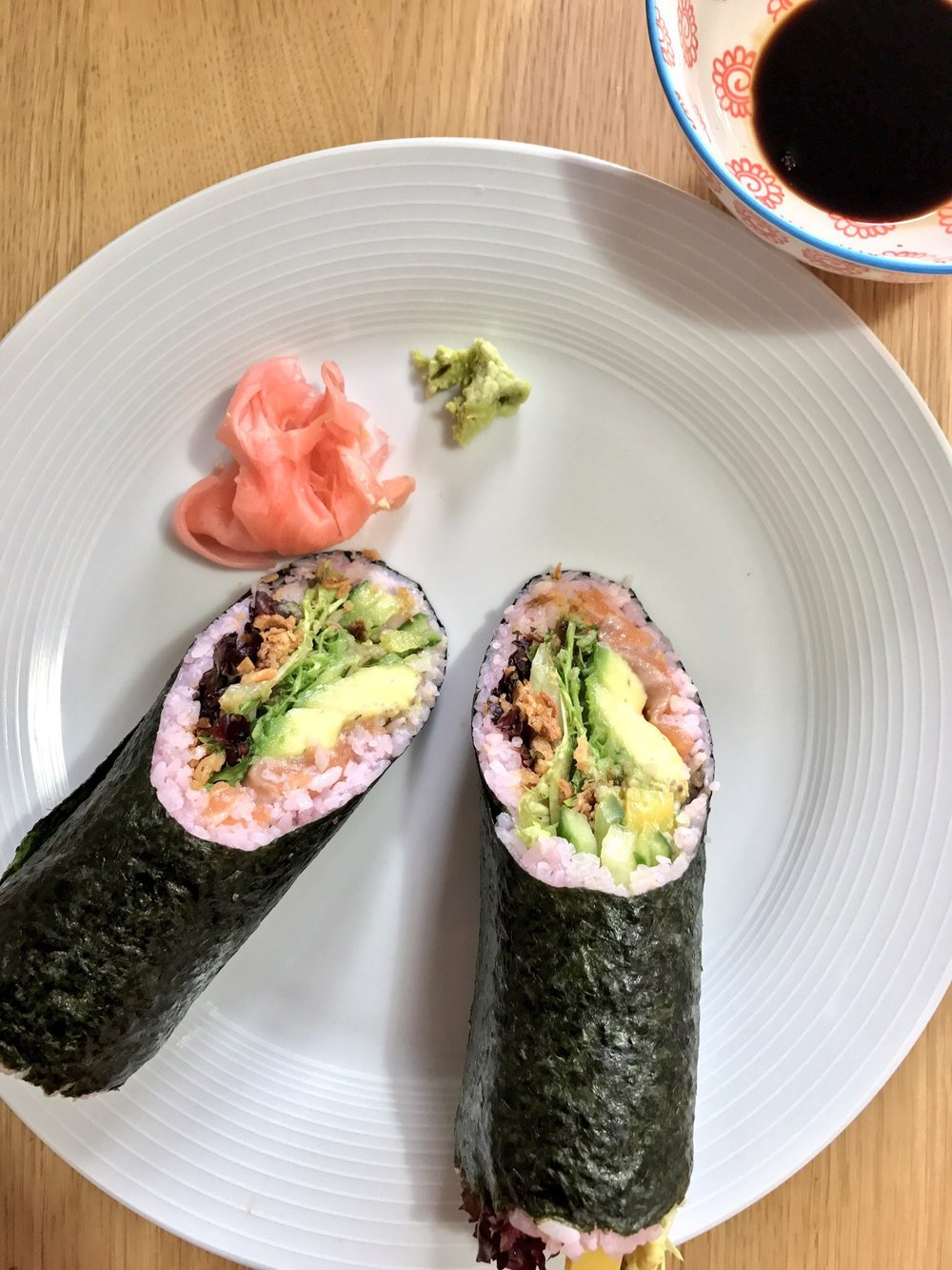 Sushi burrito salmon avocado