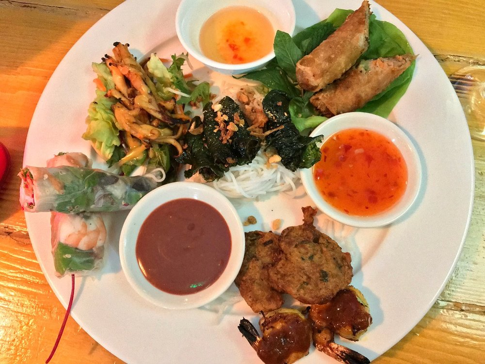 Non Viet – mixed sharing platter to start - crispy spring roll, pork & prawn summer roll, pork wrapped in betel leaf with rice vermicelli noodle, BBQ squid with salads & fried fishcakes.