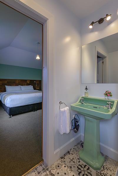 Rimu Bathroom - original green pedestal salvaged from villa.jpg