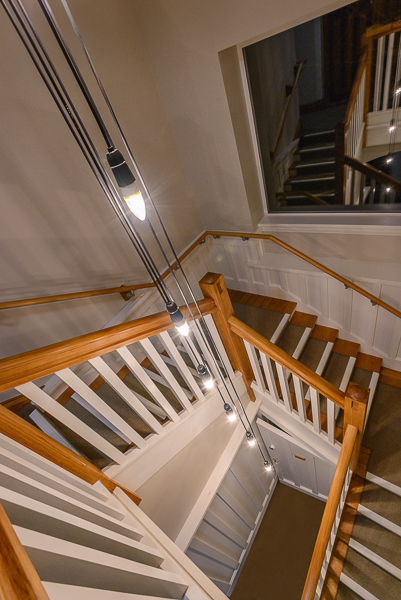 Restored staircase with feature hanging light.jpg