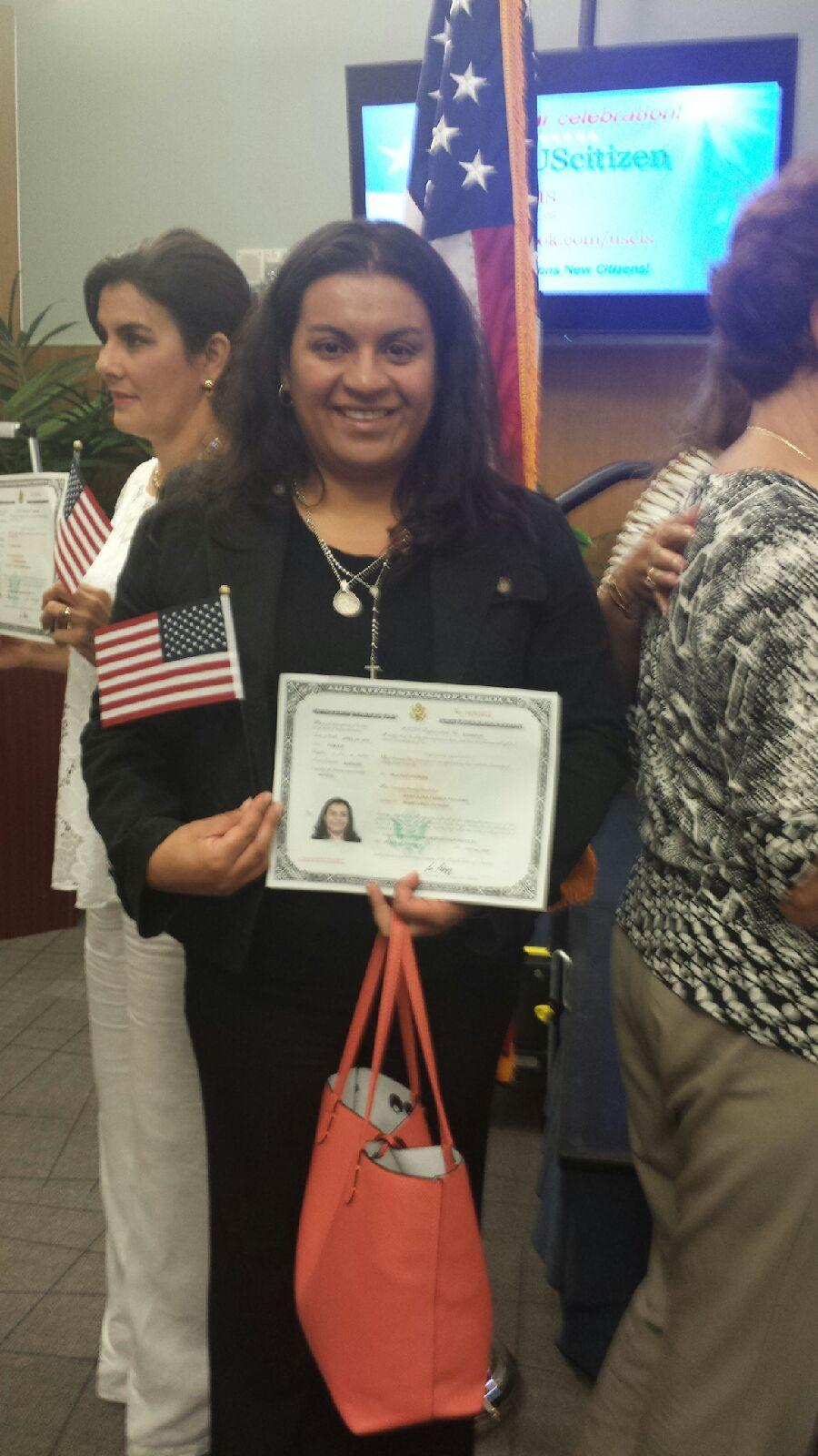 Monica proudly displays her newly received Citizenship Certificate