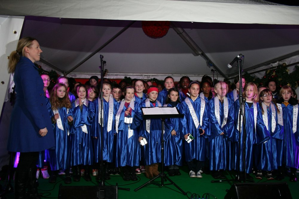 2012 - Choir Xmas Market opening Nov 3 - Rosie and choir.JPG