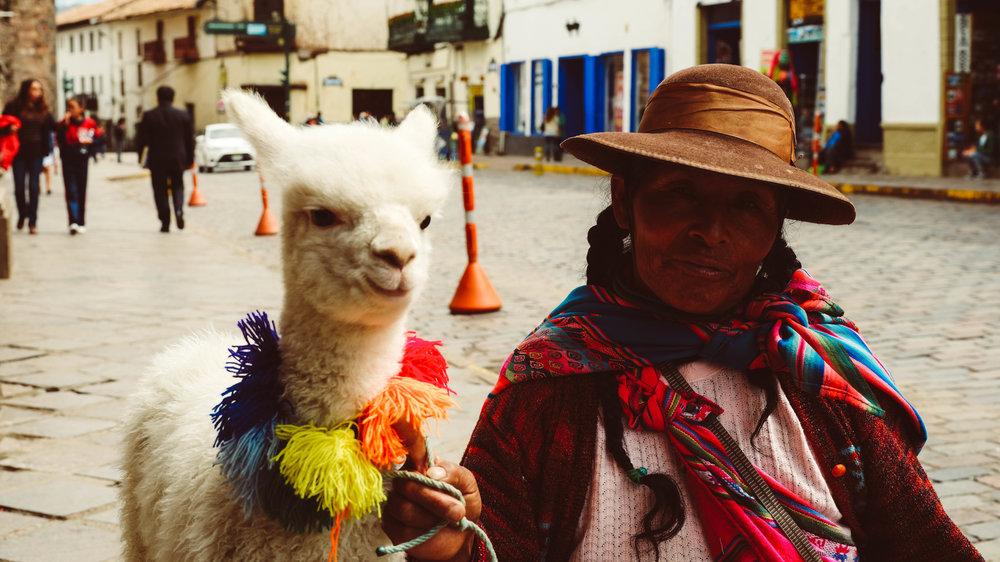 llama woman cuzco