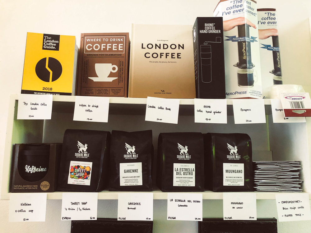 Shelf of coffee items and accoutrements at Kaffeine in London