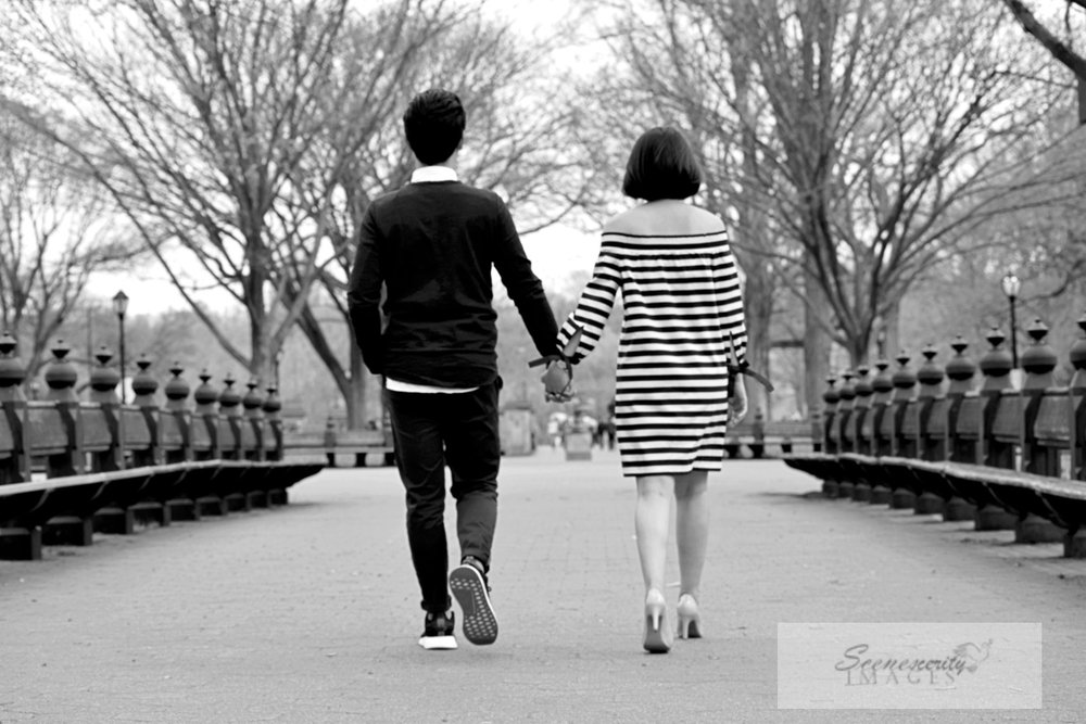 married couple walking holding hands catholic wedding photographer