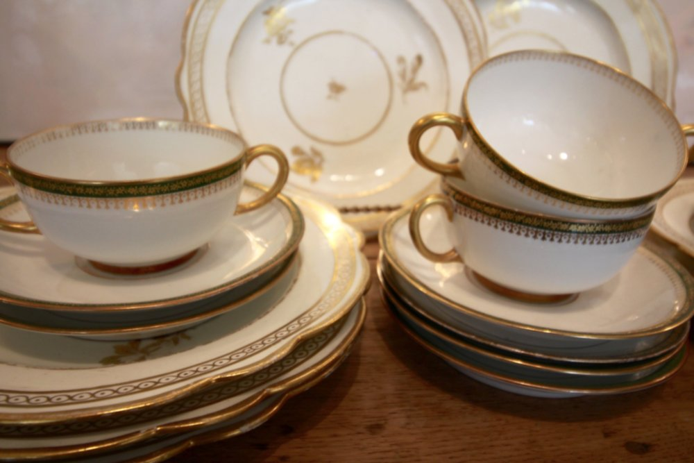 Antique tea cups and saucers set