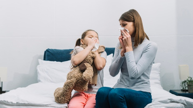 mother-looking-her-daughter-blowing-her-nose-with-tissue-paper_23-2148053313.jpg