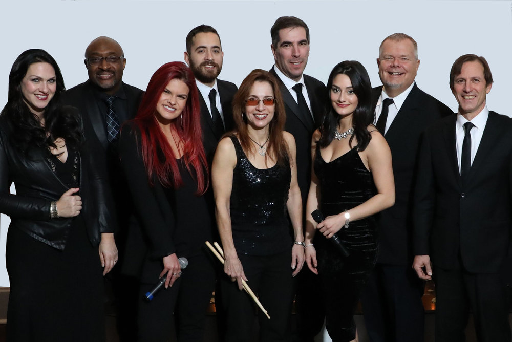 Members: Lynda McLaughlin - Vocalist, Clarinet; John Fehling - Drums; Tom Zano - Guitar, Vocals, Musical Director; Justin Flynn - Tenor Sax, Clarinet, Flute; Fred Wadlington - Vocalist; Paul Schuermann - Keyboards, Trombone, Vocals, Horn arrangements; Steve Wiseman - Trumpet; Charley Sabatino -  Electric Bass, Upright bass