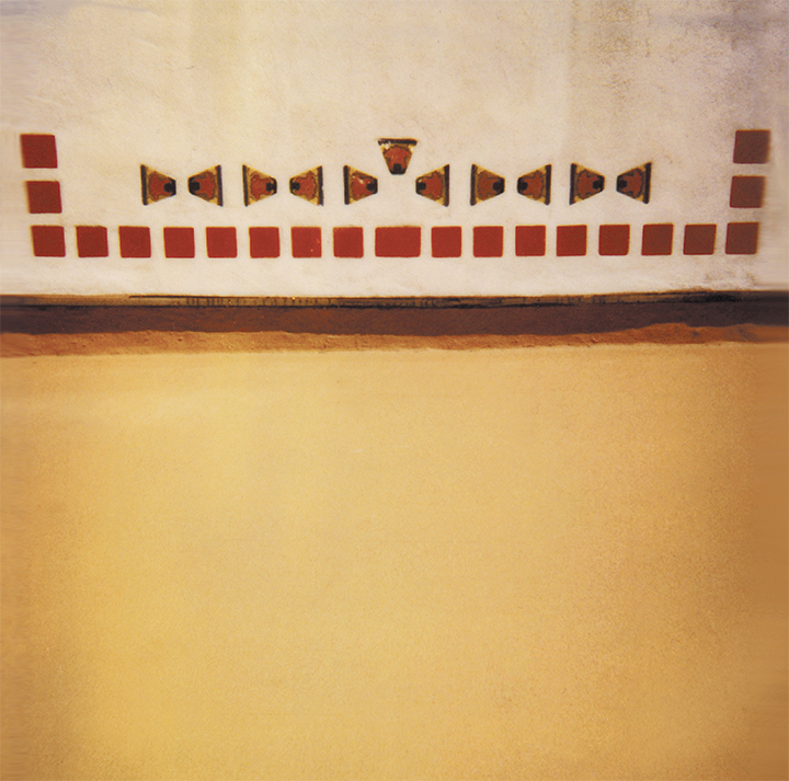 Front cover of vinyl edition of  Luxa . Polaroid of the Malibu Tiles at The Serra Retreat, Malibu, California by Harold Budd.