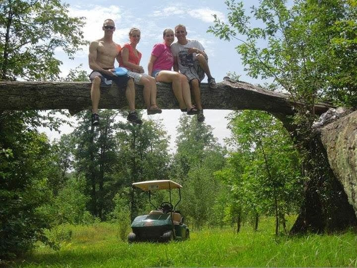 in a tree with golf cart.jpg