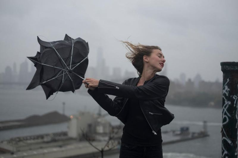 USA. Brooklyn, NY. 2015. Dasha Gavrylenko goes up on the roof of the 'kibbutz' appartment building to watch hurricane Joaquin. © David Alan Harvey