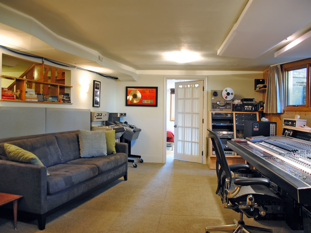 A new music recording studio was added to the lower level. The study of acoustical engineering was used in a recording studio for good sound mitigation. This was carried throughout the rest of the home: older windows were replaced with new triple-paned and louder functioning mechanicals, such as the furnace, were moved to the garage.