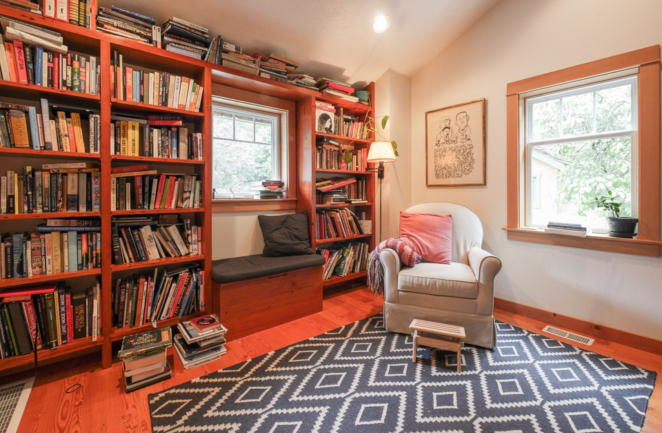 Fir wood and flooring was sourced from a warehouse that was being torn down, and a bench for toy storage and impromptu reading created a landing at the top of the stairs-turned-library.
