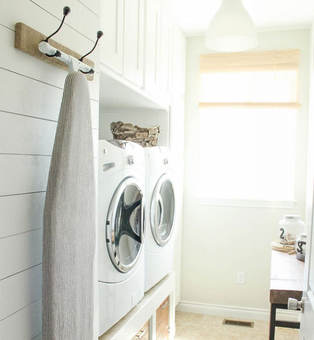 Hanging-Ironing-Board-Rack-25-Laundry-Room-Organization-Ideas-via-A-Blissful-Nest.jpg