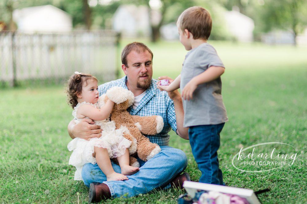 family of four poses for 2 year old birthday