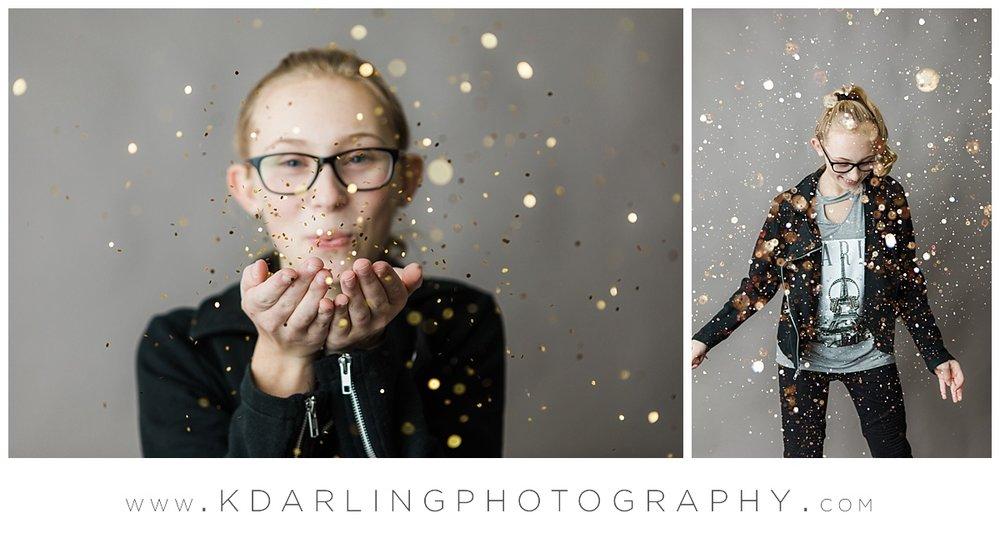 Tween girl blowing glitter