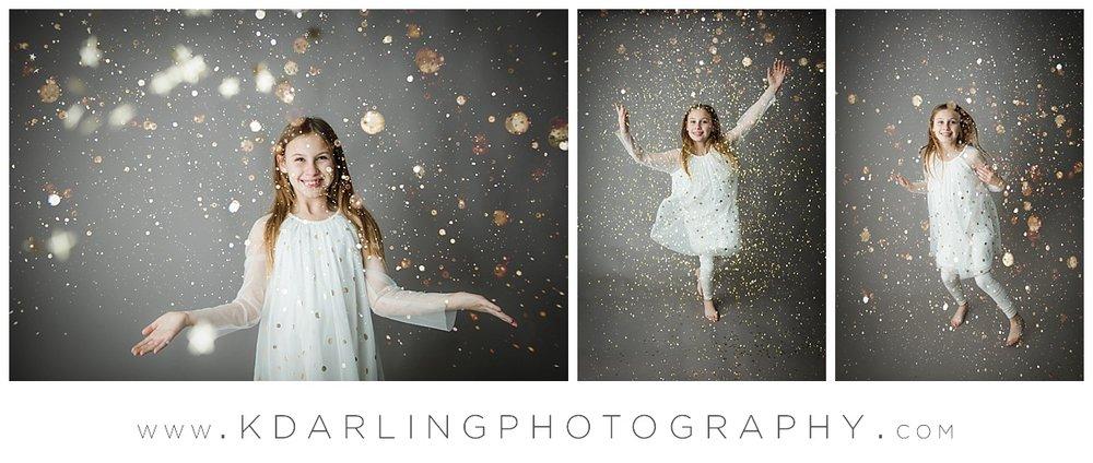 Nine year old girl having fun with gold glitter