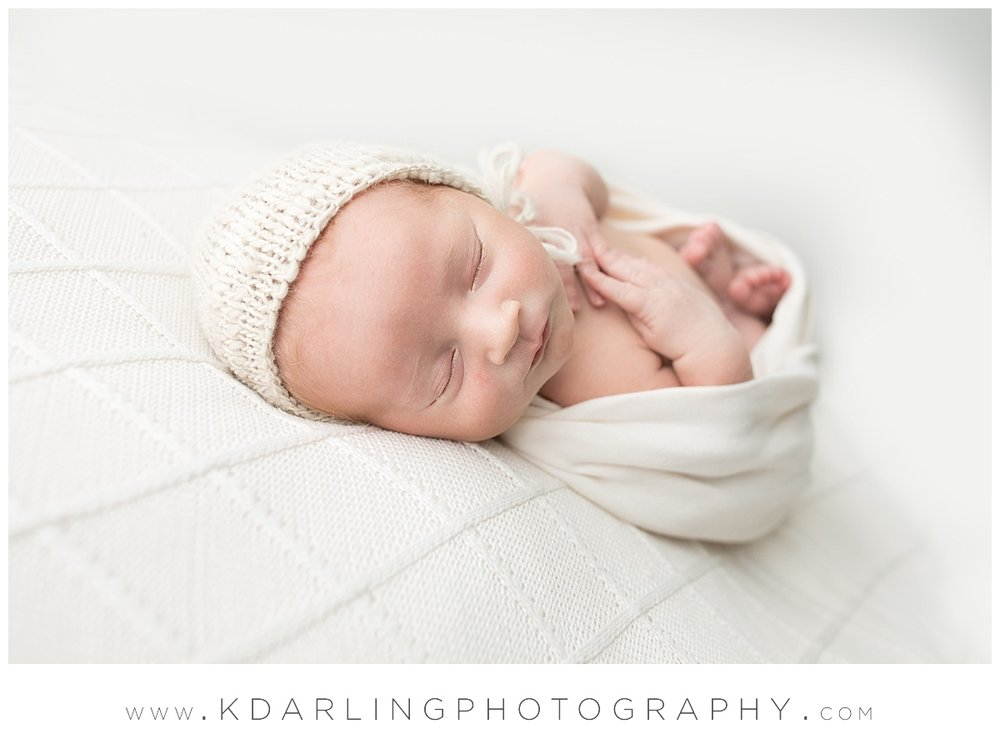 Newborn baby sleeping with hands on chest