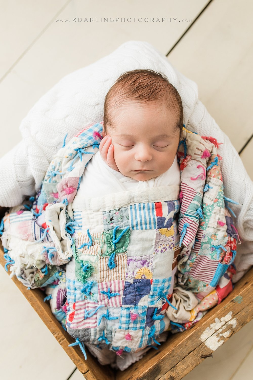 Newborn baby wrapped in a quilt