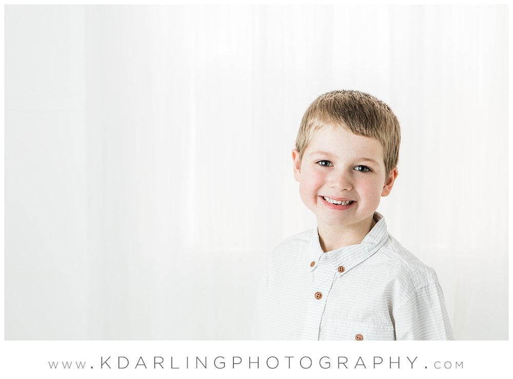 Six year old boy smiling in studio