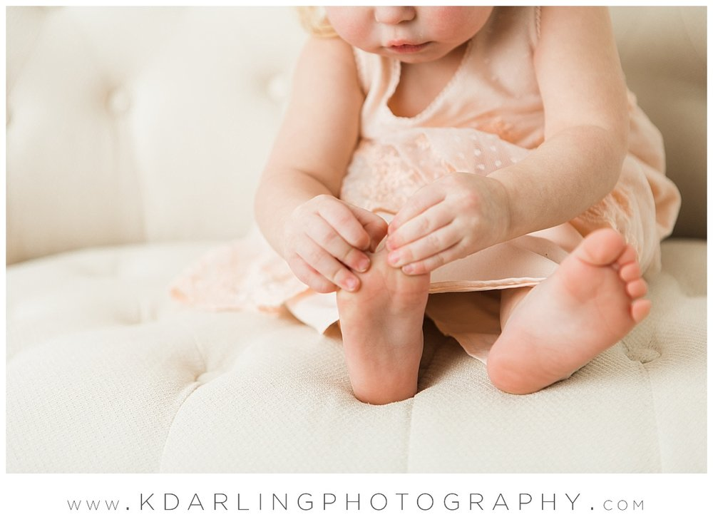 Little girl playing with her toes