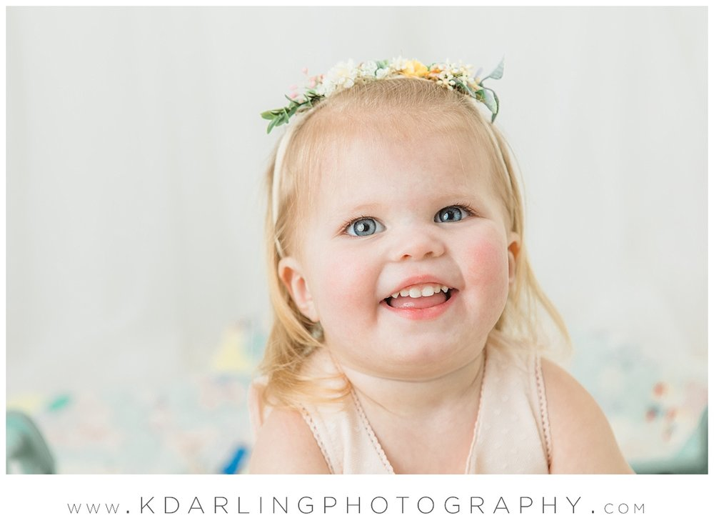 Two year old girl wearing floral crown