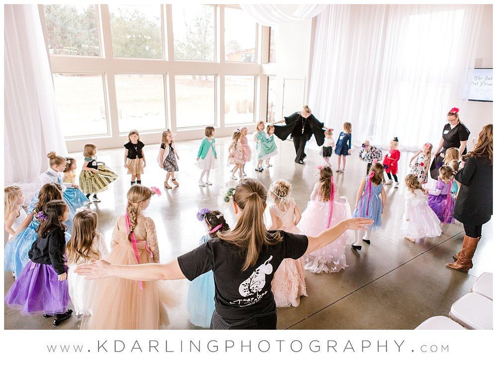 Dancing in a circle with princesses in Champaign, IL