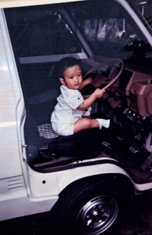Musa in his first car. Courtesy of Musa   Tjahjono.