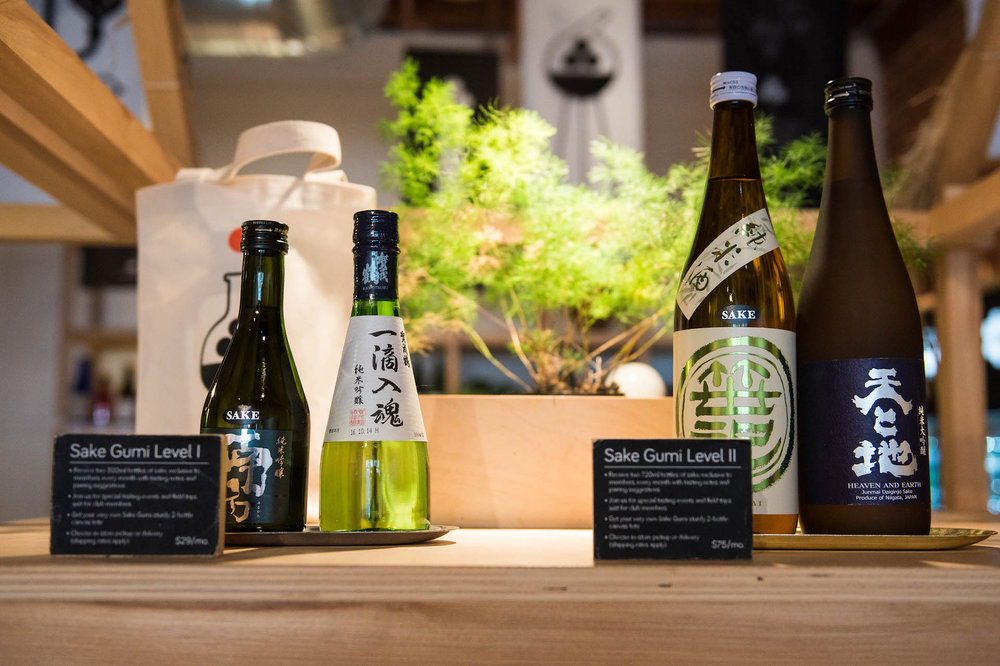 Sake bottles with detailed information.