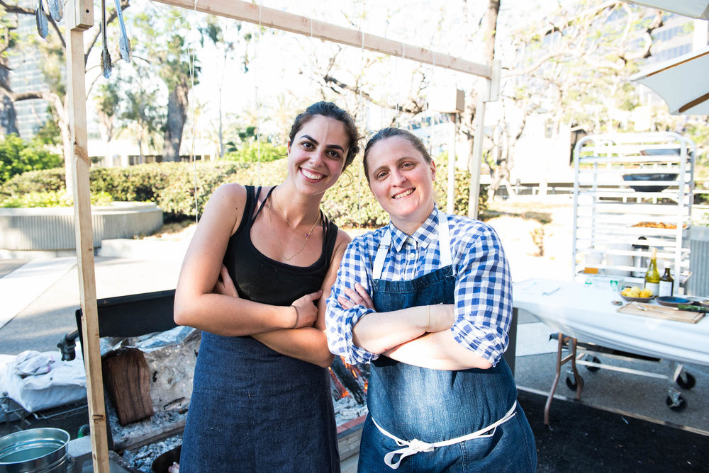 April Bloomfield (right), chef and owner of the Spotted Pig, the Breslin Bar and Dining Room, the John Dory Oyster Bar, Salvation Taco, and Tosca. On her left is Debbie Michail, local L.A. butcher and April's sous chef for Beast Feast.