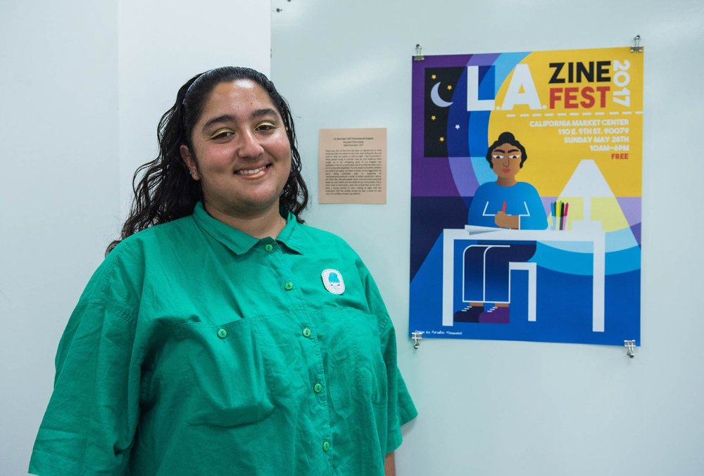 Paradise Khanmalek with the poster she designed for LAZF.