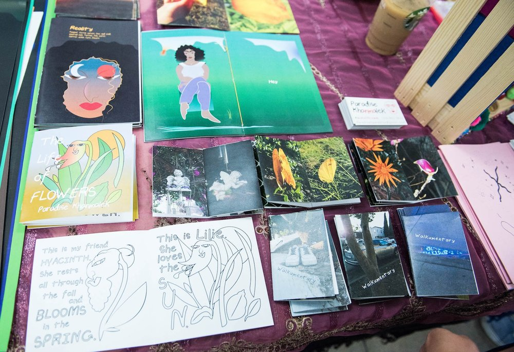 Zines at Paradise's table.