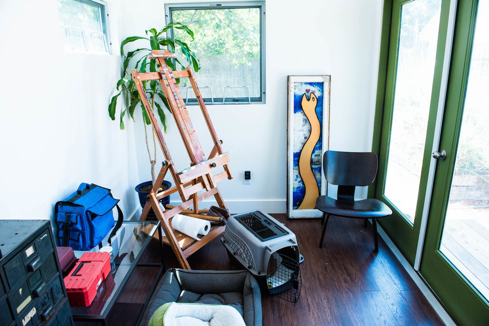 The studio is outfitted with an easel, art materials, inspiring art, and cozy places for her dogs.