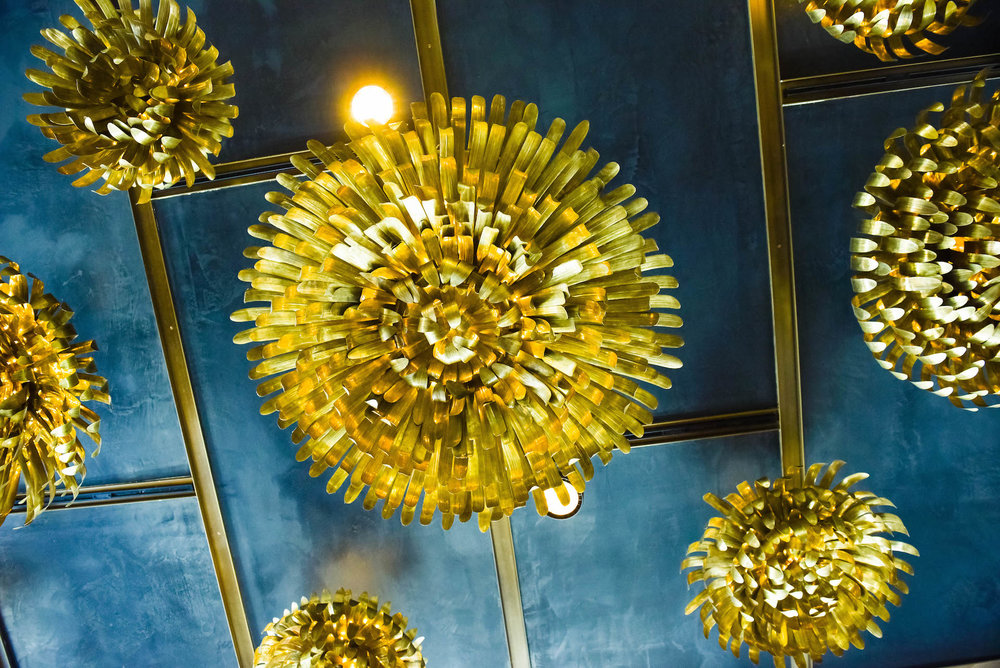 The artwork on the ceiling replicates chrysanthemums.