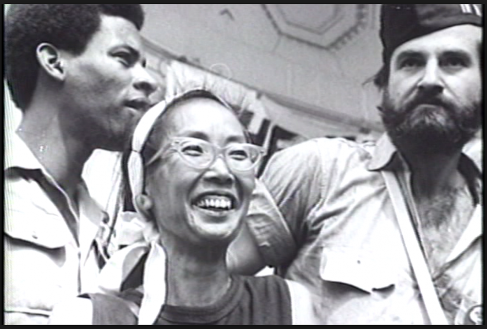 Smiling Japanese American activist, Yuri Kochiyama. Courtesy of Renee Tajima-Peña.