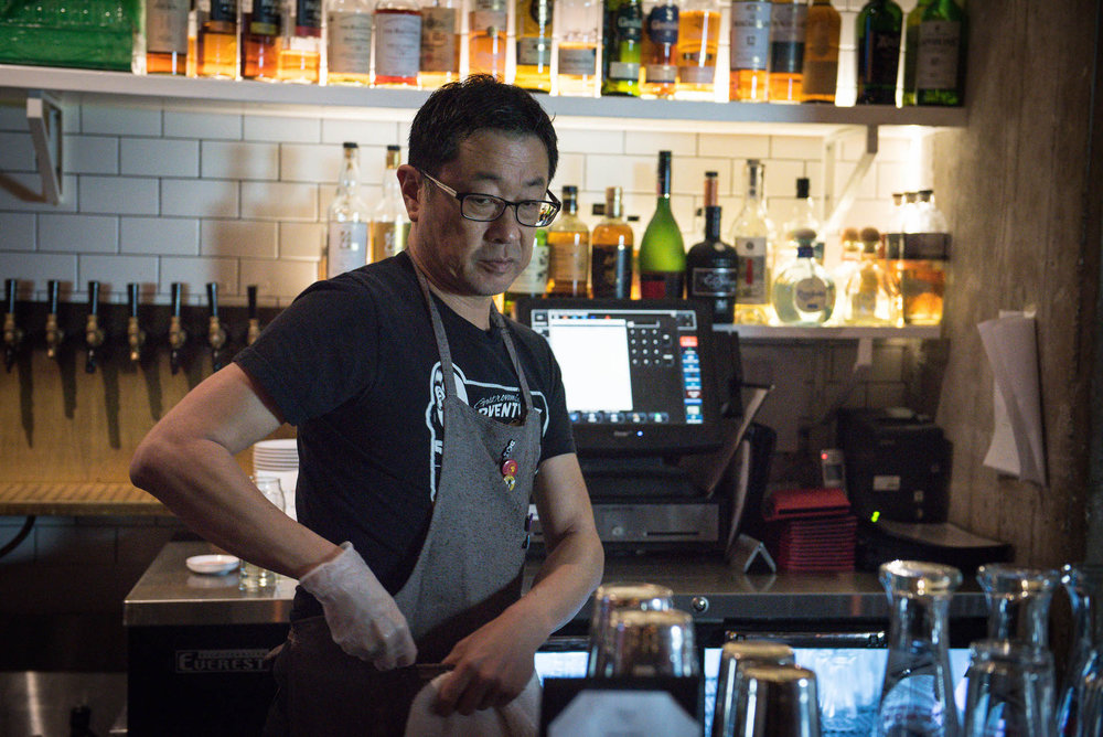 Andrew Wong, self-made bartender, architect, and fellow co-owner.