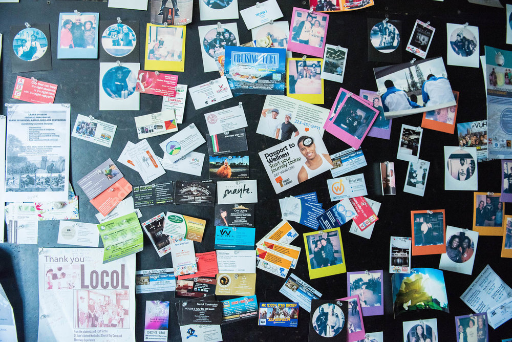 At the back of Locol is a wall just for the community. Business cards, thank you letters, and polaroids of locals adorn the wall.