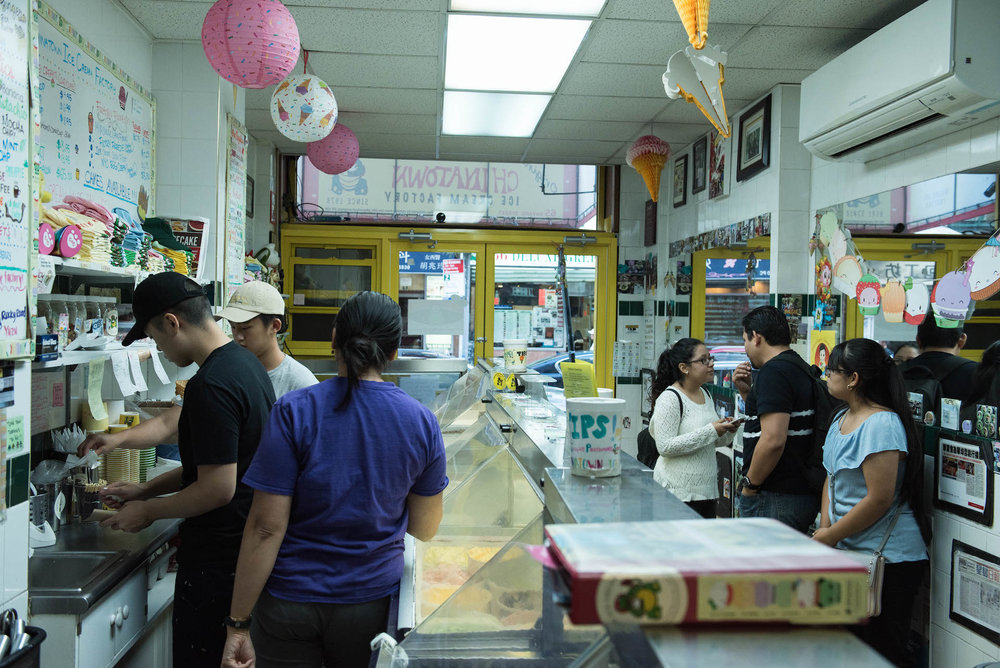 Customers wait for their ice cream at the original Chinatown Ice Cream Factory shop on Bayard Street.