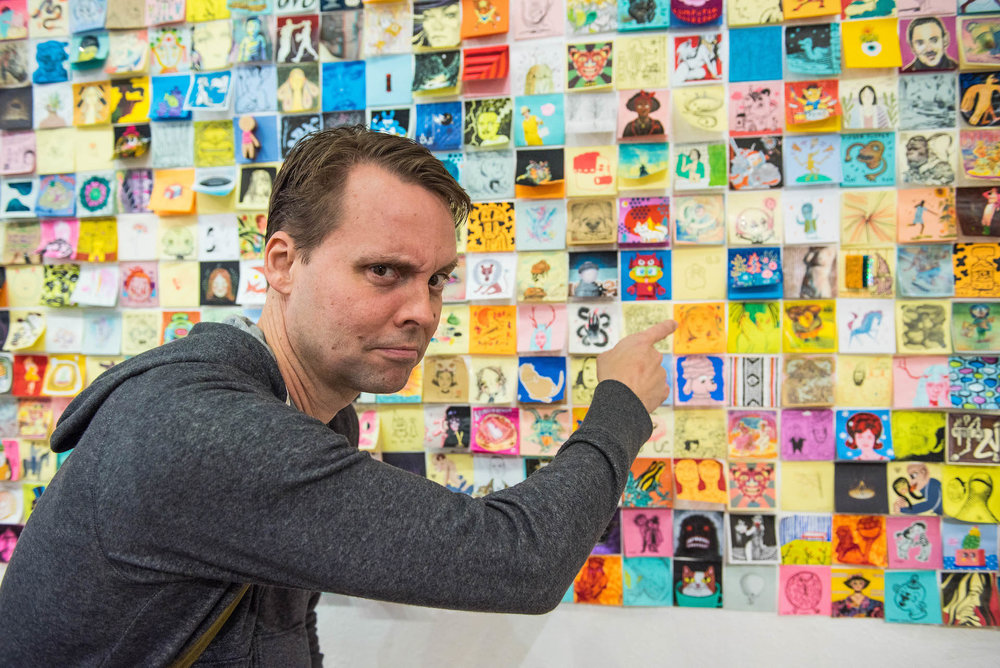 David Horvath, the co-creator of Ugly Dolls, pointing at his post-it.