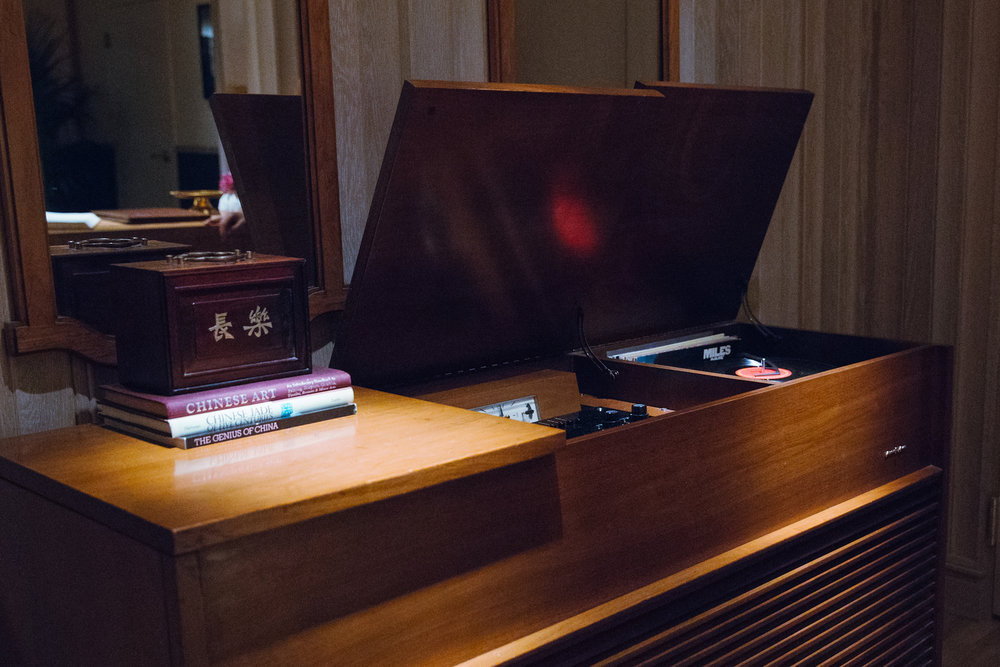 A vintage record player can be found in the foyer.