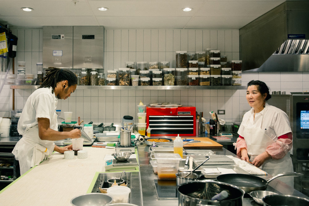 Members of the staff prep for dinner service.