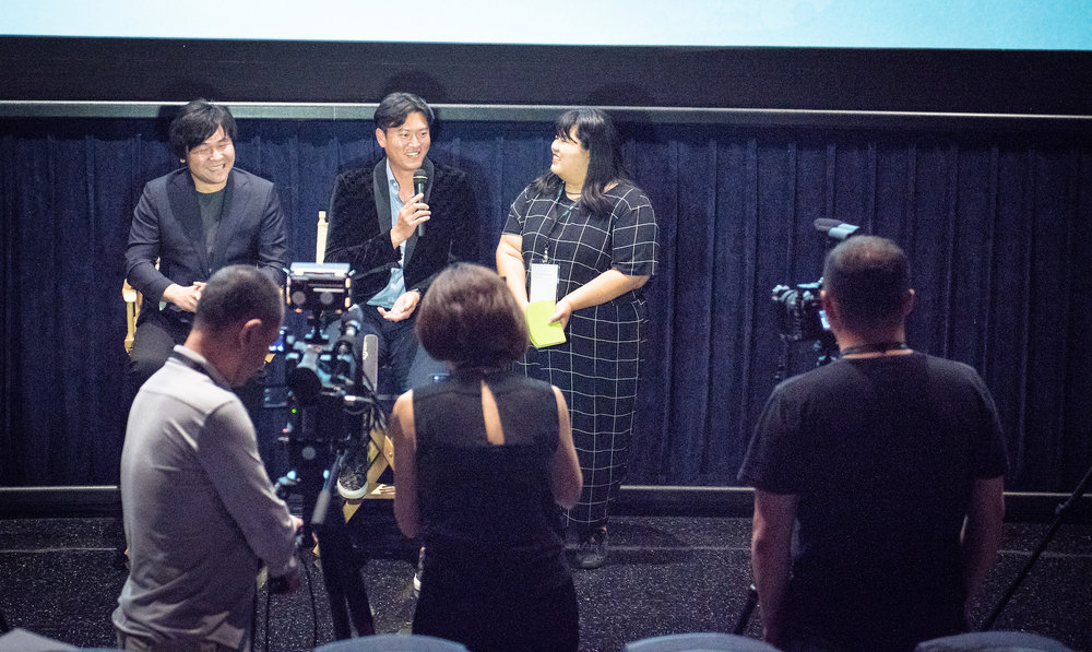Director Frank W. Chen (left) and Chien-Ming Wang (second to the left) speaking to the audience after the screening.