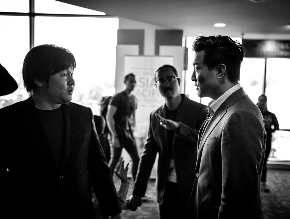 Dir. Frank W. Chen (left) talking with producer Brian Yang (right) before the premiere.