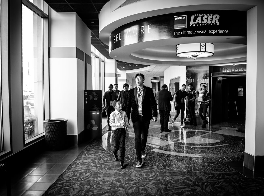 Chien-Ming Wang walking to the theater with his son. Director Frank W. Chen, Cinematographer   Hai-Tao Wu, and Producer Brian Yang follow behind them.