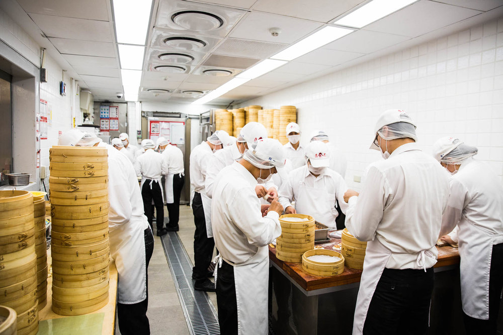 Inside the first Din Tai Fung kitchen in the world. A team of busy chefs craft soup dumplings in less than a few hundred square feet.