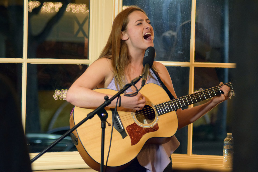 Indigo Halverson/QUAKER CAMPUS Junior Maggie Niemann performs a song for the third episode of Cozy Concerts, filmed at Lift Coffee located in Uptown Whittier.