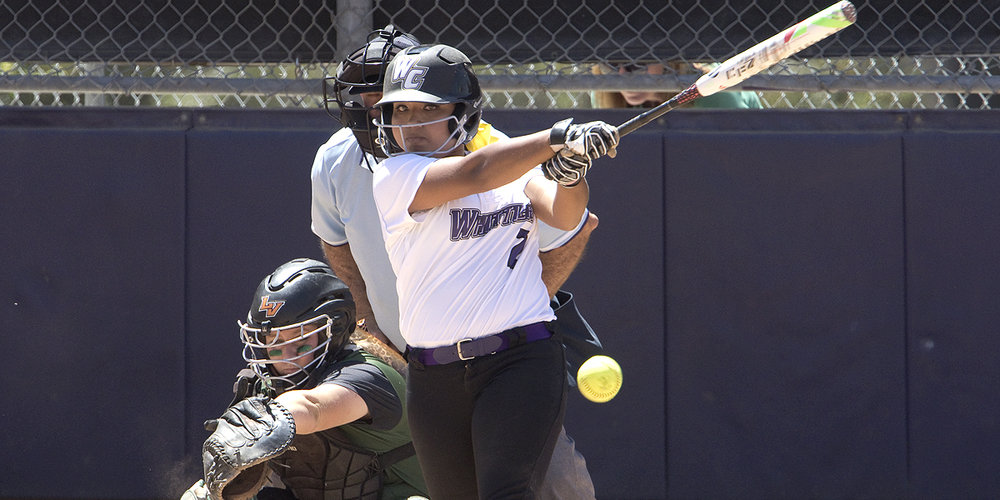 First-year corner Rebecca Barber gets a hit durng a SCIAC game against the University of La Verne earlier this season.