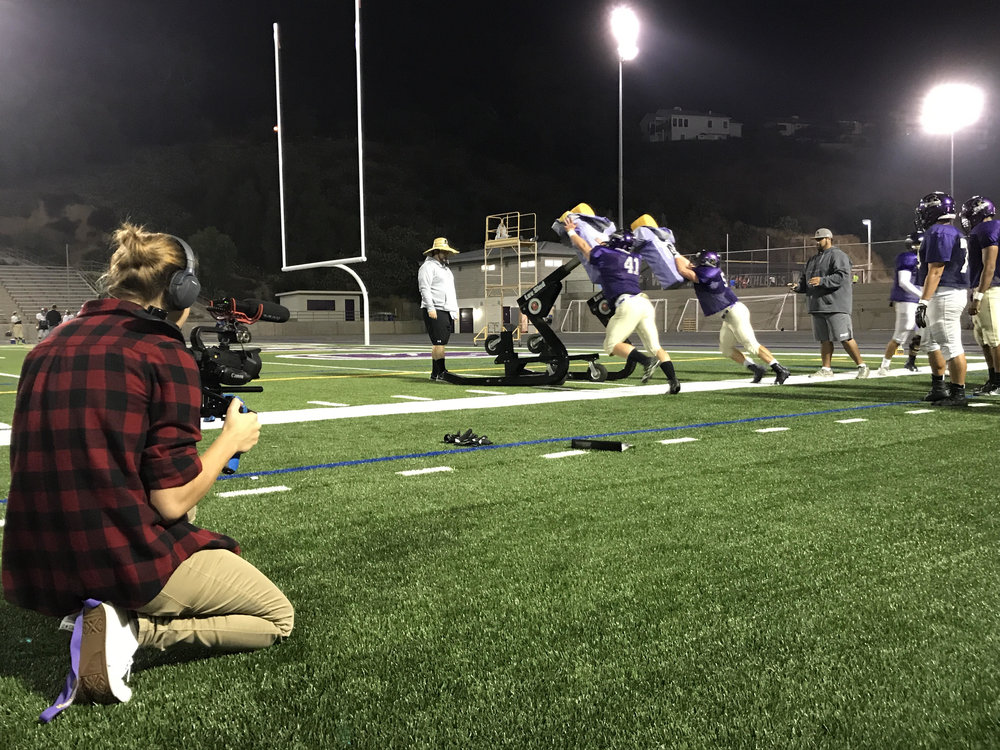 Lauren Blazey focused on capturing the best footage of players digging in and pushing the sled.