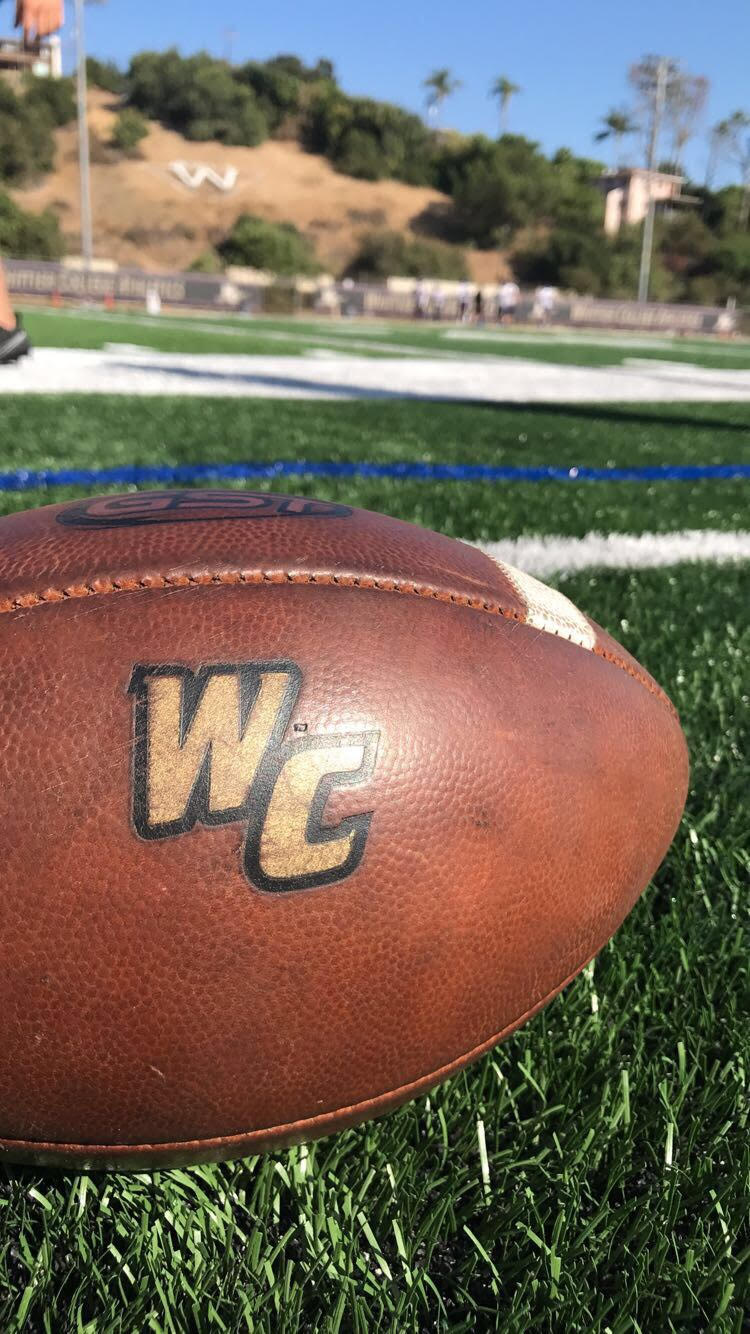 Close up of a Whittier College football resting on the Poet field.