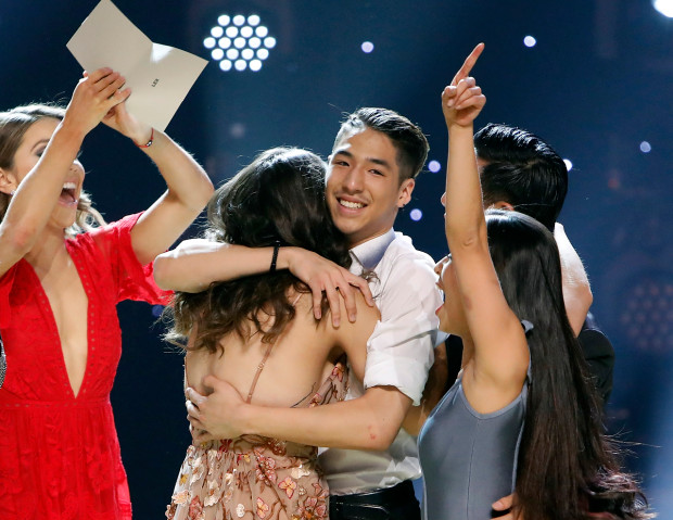 Winner Lex Ishimoto shares a hug with longtime girlfriend and top-5 contestant Taylor Sieve at the finale.